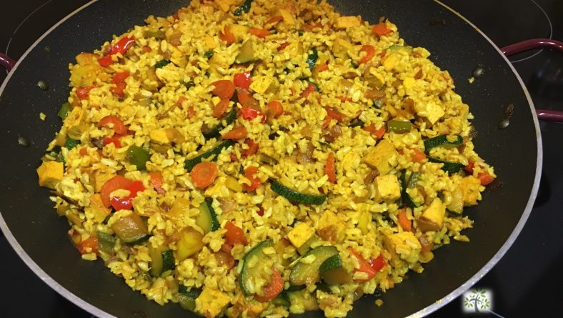 Whole-grain basmati rice with vegetables, tofu and turmeric